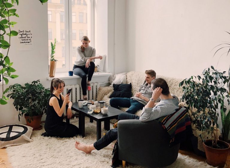 Group of people socialising in lounge.